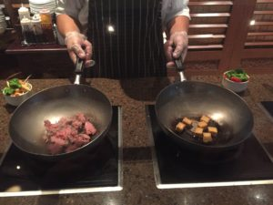 The Chef begins our wok dishes by frying up my beef and Iris's tofu